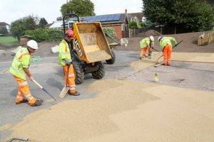 Laying surfacing at Coleshill Memorial Park