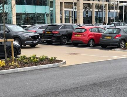 Coloured paving for parking bays